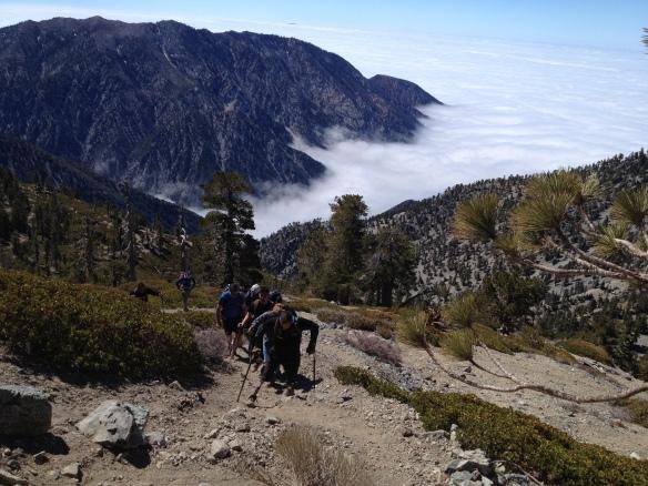 SSgt. Mark Zambon climbing toward the summit.