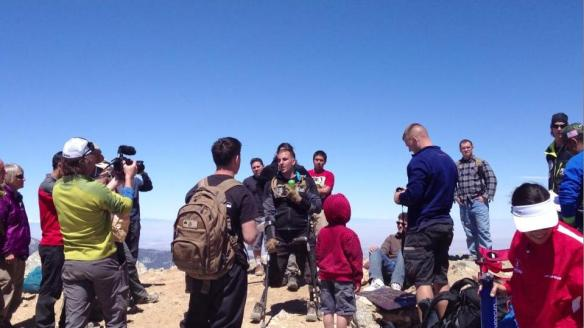 SSgt. Mark Zambon celebrates on the summit.