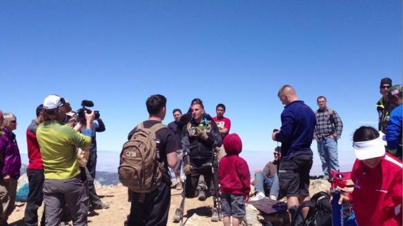 SSgt. Mark Zambon celebrates on the summit.
